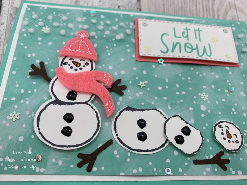 Snowman Christmas card using the Snowman Seasons stampset and punch from Stampin Up, with Shimmery Crystal Effects, Snowflake Sequins and the Let It Snow Speciality Designer Series Paper and the Let It Snow Embellishment Kit.