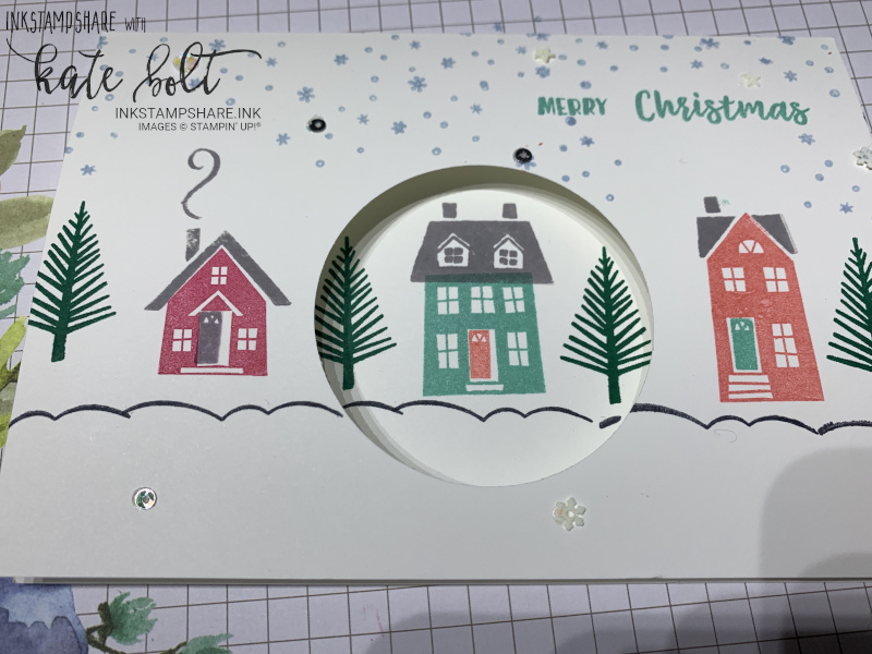 From Our House To Yours Christmas card with circle aperture.  Snowy street scene Christmas card using rubber stamping.