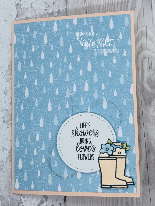 Under My Umbrella Card for the stampers showcase blog hop. Card with raindrops, welly boots with flowers in and  the sentiment Life's showers brings loves flowers.