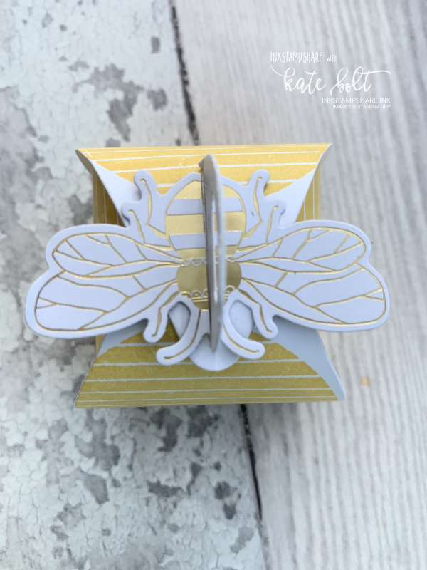 Honey Bee Gift Box in the shape of a bee hive with a bee hive stamped around the sides and  a gold and  white bee on top.