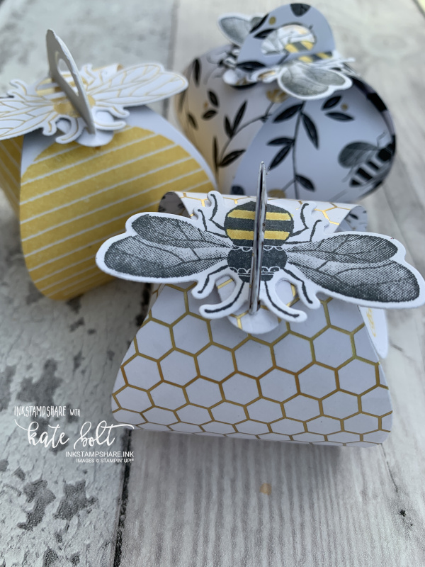 Three little Honey Bee gift boxes with bees on top. made using the Mini Curvy Keepsakes box dies from Stampin Up!