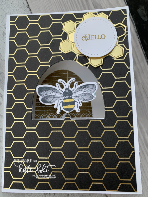 Honey bee spinner card for the Inspire Create Challenge #063 movement theme. Gold and  black card featuring a spinning bee in a bee hive aperture.