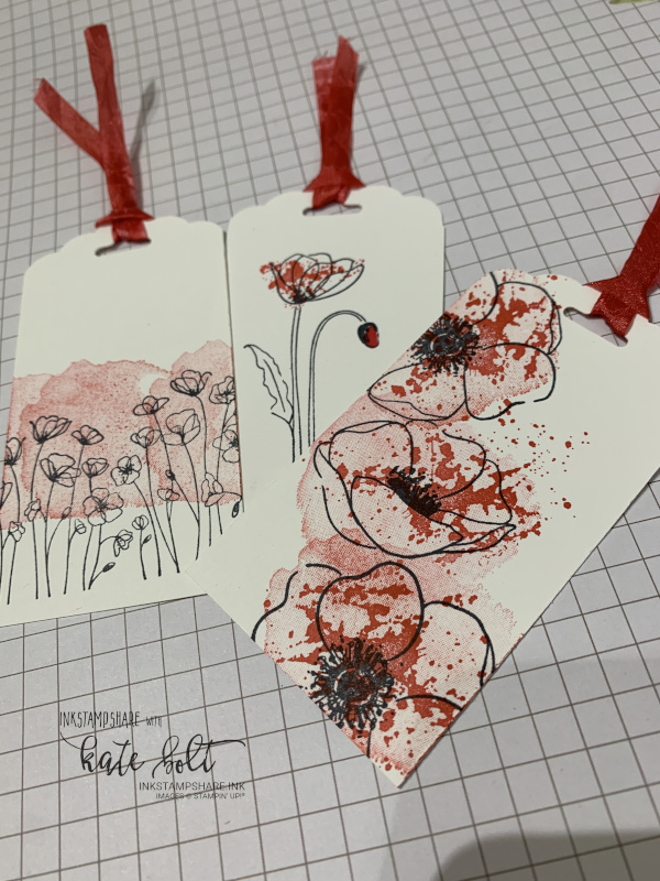 Tags using the scalloped tag topper punch and  the Painted Poppies stamp set. The white ribbon is coloured to match using Poppy Parade Marker.