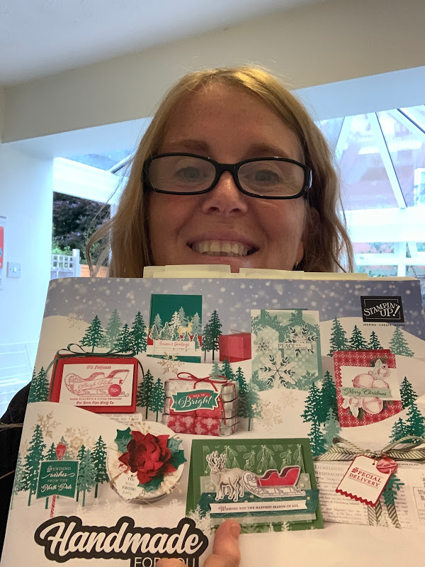 New Christmas catalogue selfie with pages marked with post it notes.