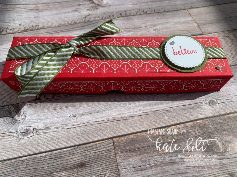 Tealight Christmas gift box using the Heart Warming Hugs Papers in traditional reds and  greens. With Believe stamped and  Mossy Meadow ribbon.