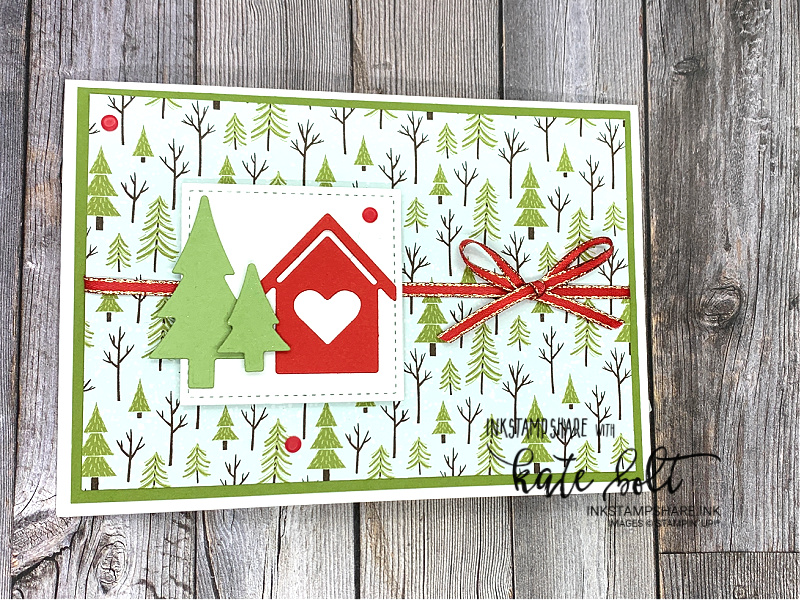 Looking forward to Christmas -Christmas card with little house from the Trimming The Town Suite and  die cut trees. With Old Olive ribbon. The Trimming The Town Paper as  the background.The sentiment says believe.
