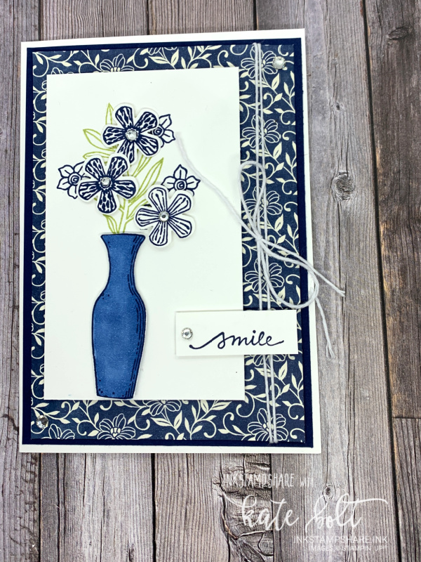 Positive Inkers Blog Hop November. Card in Night Of Navy and  White using the Basket Of Blooms stamp set. The card features a vase of flowers and  says smile.