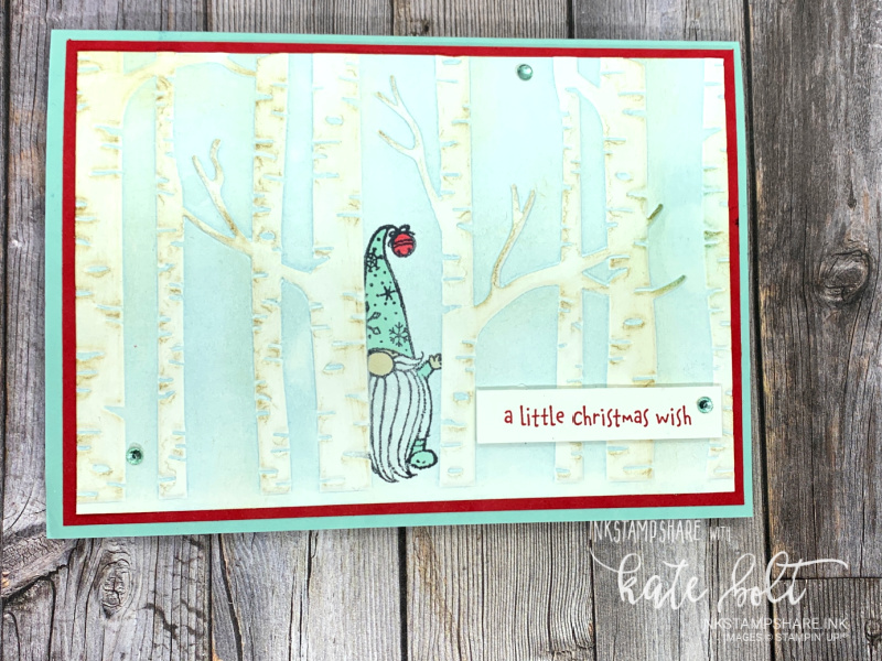 Gnome For The Holidays Christmas card using the Woodland Embossing Folder Technique. A little gnome half hidden hidden in the forest, peeking out with the sentiment, A Christmas Wish. You can see how it's made in this blog post/ YouTube tutorial from Inkstampshare