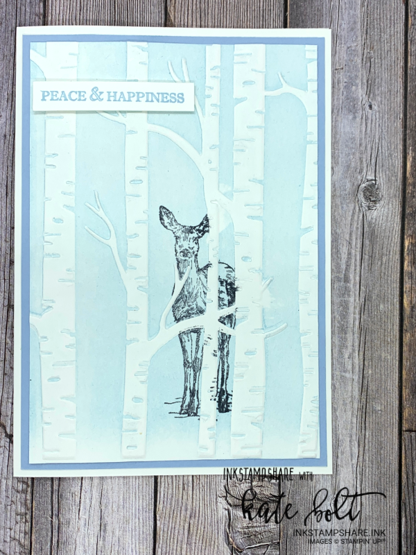 Christmas card using the Woodland Embossing Folder Technique. A deer half hidden hidden in the forest, peeking out with the sentiment, Peace And Happiness You can see how it's made in this blog post/ YouTube tutorial from Inkstampshare