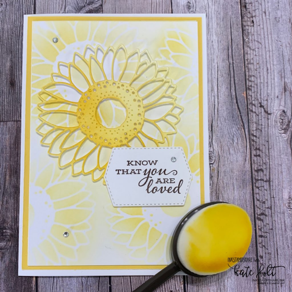 Hand made card featuring a soft background of sunflowers and  a sunflower die coloured with Daffodil Delight ink using blending brushes. All products from Stampin' Up! Made by inkstampshare.ink